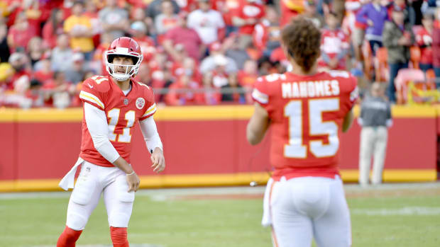 Nov 26, 2017; Kansas City, MO, USA; Kansas City Chiefs quarterback Alex Smith (11) throws passes to quarterback Patrick Mahomes (15) on the sidelines during the second half against the Buffalo Bills at Arrowhead Stadium. Mandatory Credit: Denny Medley-USA TODAY Sports