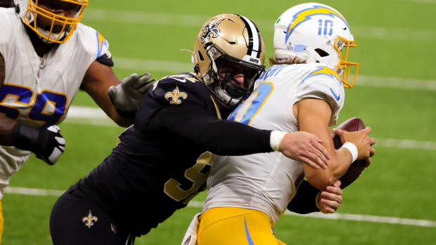 Oct 12, 2020; New Orleans, Louisiana, USA; New Orleans Saints defensive end Trey Hendrickson (91) sacks Los Angeles Chargers quarterback Justin Herbert (10) during the first quarter at the Mercedes-Benz Superdome. Mandatory Credit: Derick E. Hingle-USA TODAY Sports