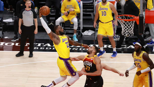 Feb 24, 2021; Salt Lake City, Utah, USA; Los Angeles Lakers forward LeBron James (23) dunks the ball over Utah Jazz center Rudy Gobert (27) during the second quarter at Vivint Smart Home Arena. Mandatory Credit: Chris Nicoll-USA TODAY Sports