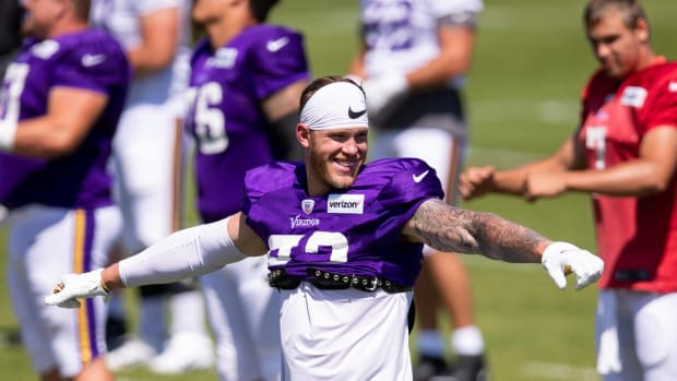 Aug 18, 2020; Eagan, Minnesota, United States; Minnesota Vikings tight end Kyle Rudolph (82) warms up at training camp at TCO Performance Center. Mandatory Credit: Brad Rempel-USA TODAY Sports