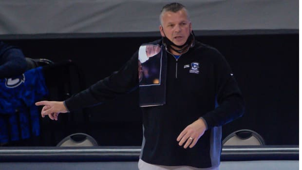 Feb 24, 2021; Omaha, Nebraska, USA; Creighton Bluejays head coach Greg McDermott wears a towel in memory of former Georgetown head coach John Thompson against the DePaul Blue Demons in the first half at CHI Health Center Omaha.