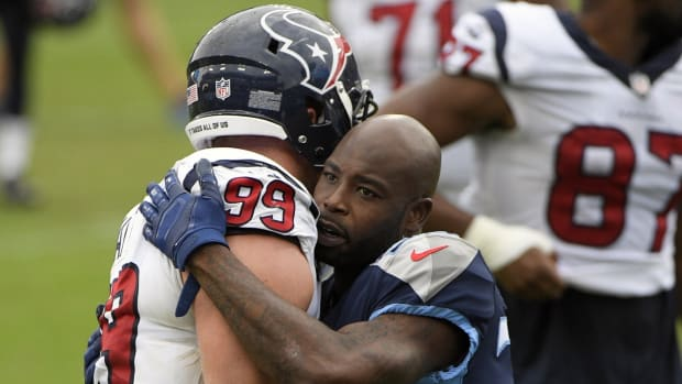 Tennessee Titans cornerback Tye Smith (23) talks with Houston Texans defensive end J.J. Watt (99) after the game at Nissan Stadium.