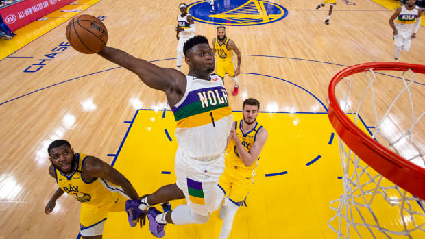 Zion Williamson dunking against the Warriors.