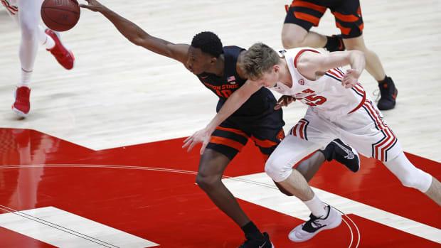 Mar 3, 2021; Salt Lake City, Utah, USA; Oregon State Beavers forward Warith Alatishe (10) beats Utah Utes center Branden Carlson (35) to the ball in the first half at Jon M. Huntsman Center.