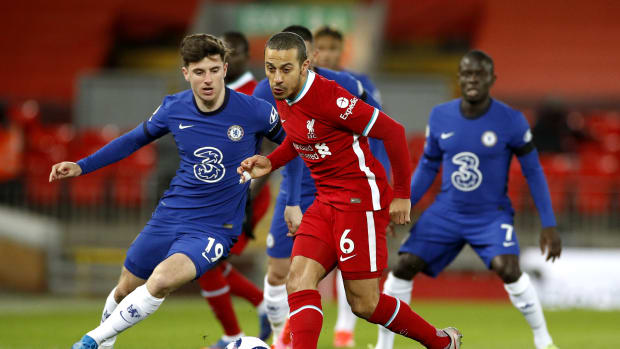 Thiago battles with Mason Mount during Liverpool v Chelsea