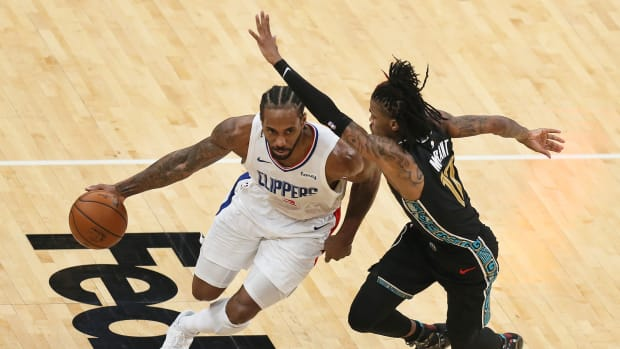 Feb 26, 2021; Memphis, Tennessee, USA; Los Angeles Clippers forward Kawhi Leonard (2) drives against Memphis Grizzlies guard Ja Morant (12) in the third quarter at FedExForum. Mandatory Credit: Nelson Chenault-USA TODAY Sports