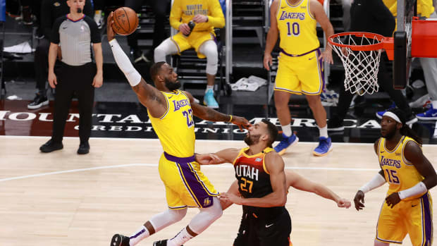 Feb 24, 2021; Salt Lake City, Utah, USA; Los Angeles Lakers forward LeBron James (23) dunks the ball over Utah Jazz center Rudy Gobert (27) during the second quarter at Vivint Smart Home Arena.