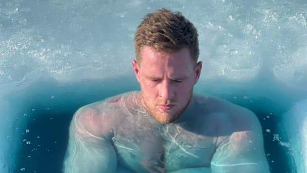 JJ Watt submerged in a frozen lake