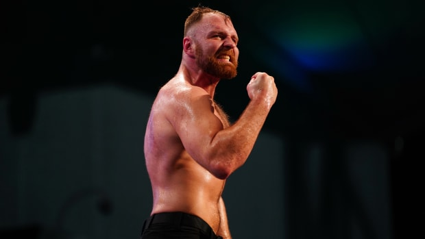 AEW's Jon Moxley poses in the ring after a match