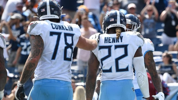Tennessee Titans offensive tackle Jack Conklin (78) congratulates running back Derrick Henry (22) after his touchdown during the third quarter at Nissan Stadium Sunday, Sept. 15, 2019 in Nashville, Tenn.