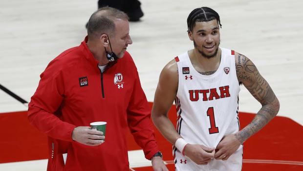 Mar 6, 2021; Salt Lake City, Utah, USA; Utah Utes head coach Larry Krystkowiak and forward Timmy Allen (1) react on the way to the locker room at halftime against the Arizona State Sun Devils at Jon M. Huntsman Center.