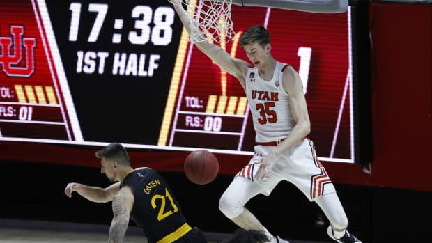 Mar 6, 2021; Salt Lake City, Utah, USA; Utah Utes center Branden Carlson (35) dunks against Arizona State Sun Devils forward Chris Osten (21) in the first half at Jon M. Huntsman Center.