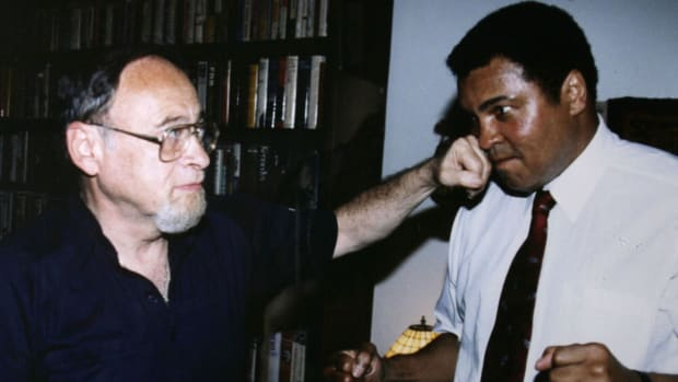 Sportswriter Jerry Izenberg lands a friendly punch on Muhammad Ali.