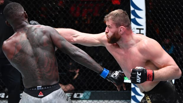 Jan Blachowicz of Poland punches Israel Adesanya of Nigeria in their UFC light heavyweight championship fight during the UFC 259 event at UFC APEX on March 06, 2021 in Las Vegas, Nevada.
