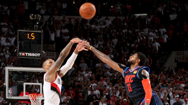 Damian Lillard and Paul George square off
