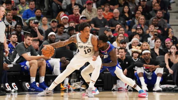 Nov 29, 2019; San Antonio, TX, USA; San Antonio Spurs guard DeMar DeRozan (10) backs in against LA Clippers guard Patrick Beverley (21) during the second half at the AT&T Center. Mandatory Credit: Daniel Dunn-USA TODAY Sports