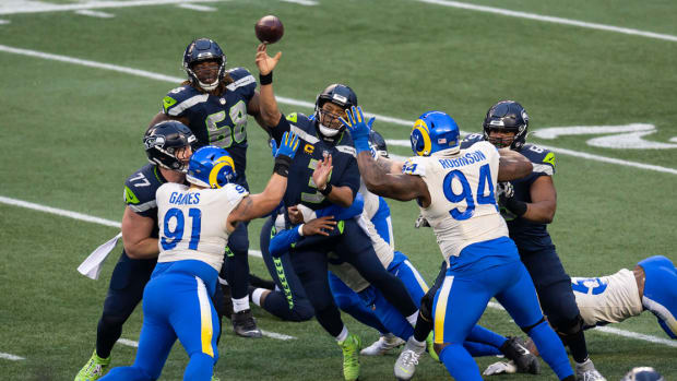 Seattle Seahawks quarterback Russell Wilson (3) gets passes the ball before getting sacked during the second half against the Los Angeles Rams at Lumen Field.