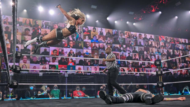 WWE's Toni Storm diving in the ring on NXT