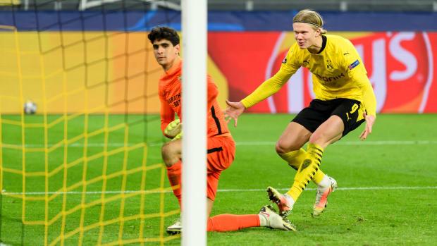 Dortmund's Erling Haaland taunts the Sevilla goalkeeper after a penalty