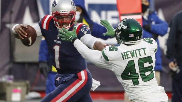 Jets Neville Hewitt tackling Cam Newton