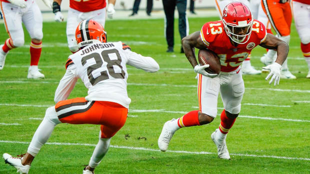 Jan 17, 2021; Kansas City, Missouri, USA; Kansas City Chiefs wide receiver Byron Pringle (13) runs against Cleveland Browns cornerback Kevin Johnson (28) during the first half in an AFC Divisional Round playoff game at Arrowhead Stadium. Mandatory Credit: Jay Biggerstaff-USA TODAY Sports