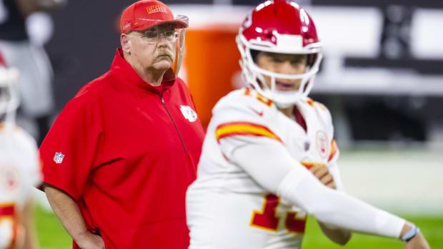 Kansas City Chiefs head coach Andy Reid watches quarterback Patrick Mahomes (15) against the Las Vegas Raiders at Allegiant Stadium.