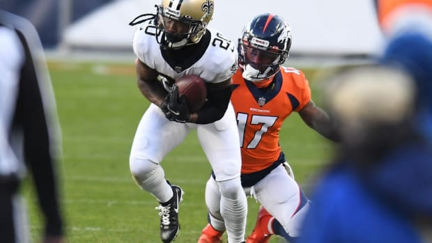 New Orleans Saints cornerback Janoris Jenkins (20) intercepts a pass intended for Denver Broncos wide receiver DaeSean Hamilton (17) in the second quarter at Empower Field at Mile High.