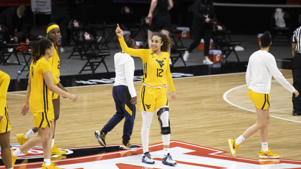March 13, 2021; Kansas City, MO, USA; West Virginia Mountaineers forward Esmery Martinez (12) smiles after defeating the Oklahoma State Cowgirls at Municipal Auditorium.