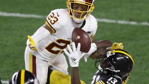 Washington Football Team cornerback Ronald Darby (23) breaks up a pass intended or Pittsburgh Steelers wide receiver James Washington (13) during the first quarter at Heinz Field.