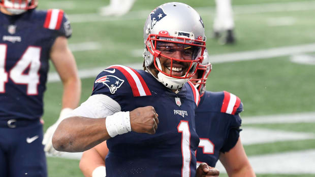 Cam Newton celebrates a touchdown for the Patriots in the final game of the 2020 season.