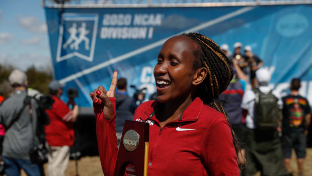 Mercy Chelangat with her national championship tropy