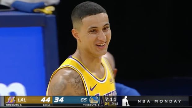 Kyle Kuzma smiles after badly missing a free throw