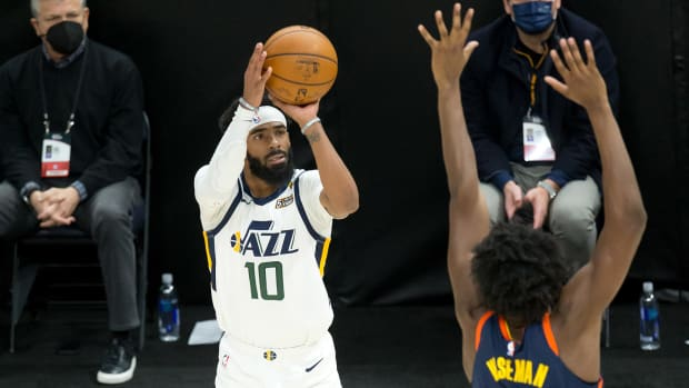 Jazz point guard Mike Conley and Warriors center James Wiseman