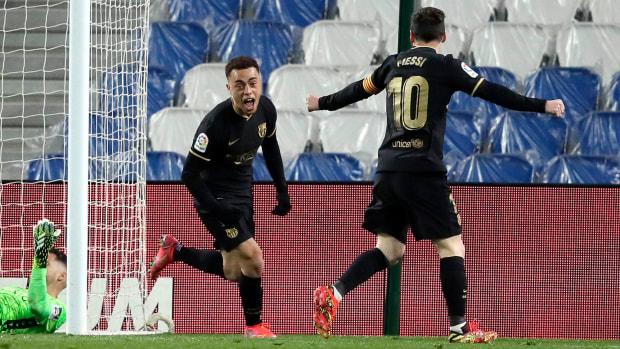 Sergiño Dest celebrates with Lionel Messi after scoring for Barcelona