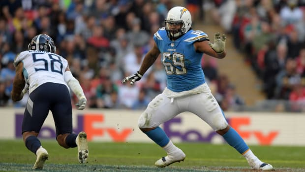 Oct 21, 2018; London, United Kingdom; Los Angeles Chargers offensive tackle Sam Tevi (69) defends against Tennessee Titans linebacker Harold Landry (58) in the second half during an NFL International Series game at Wembley Stadium. The Chargers defeated the Titans 20-19. Mandatory Credit: Kirby Lee-USA TODAY Sports