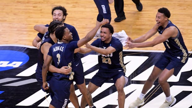 Oral Roberts players celebrate after winning NCAA tournament game