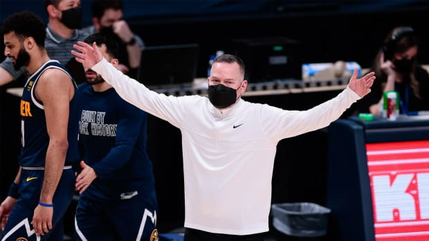 Feb 25, 2021; Denver, Colorado, USA; Denver Nuggets head coach Michael Malone reacts in the third quarter against the Washington Wizards at Ball Arena.