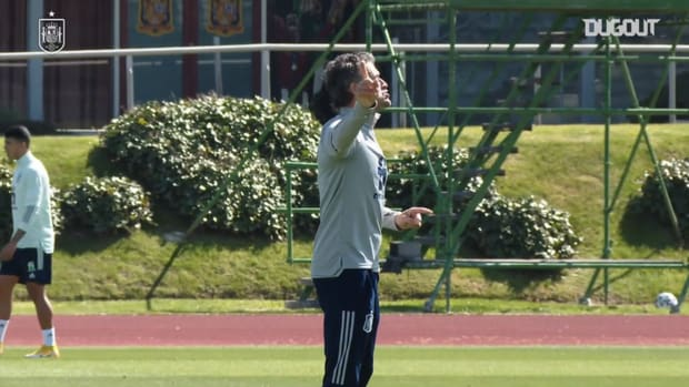 Luis Enrique directs his players in training