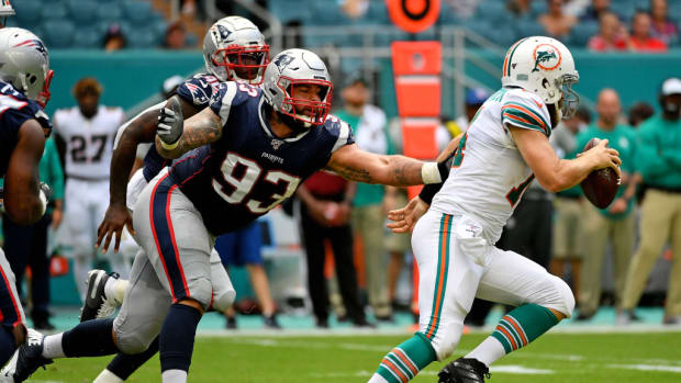 Lawrence Guy chases down Ryan Fitzpatrick in a game against the Miami Dolphins