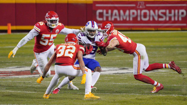Jan 24, 2021; Kansas City, MO, USA; Buffalo Bills wide receiver Isaiah McKenzie (19) runs between Kansas City Chiefs strong safety Tyrann Mathieu (32), defensive end Frank Clark (55) and free safety Daniel Sorensen (49) during the fourth quarter in the AFC Championship Game at Arrowhead Stadium. Mandatory Credit: Denny Medley-USA TODAY Sports