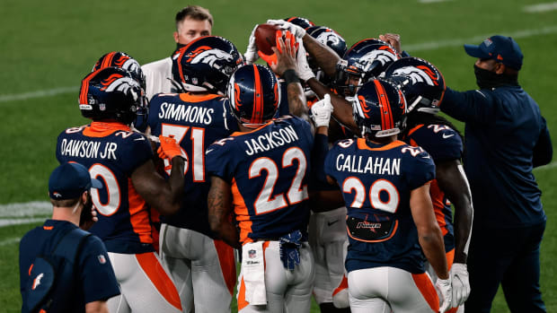 Denver Broncos cornerback Duke Dawson Jr. (20) and free safety Justin Simmons (31) and strong safety Kareem Jackson (22) and cornerback Bryce Callahan (29) with teammates before the game against the Tennessee Titans at Coors Field.