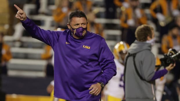 Dec 5, 2020; Baton Rouge, Louisiana, USA; LSU Tigers head coach Ed Orgeron watches warm ups prior to kickoff against the Alabama Crimson Tide at Tiger Stadium.