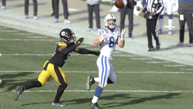 Dec 27, 2020; Pittsburgh, Pennsylvania, USA; Indianapolis Colts tight end Jack Doyle (84) makes a catch against Pittsburgh Steelers inside linebacker Avery Williamson (51) during the second quarter at Heinz Field. Mandatory Credit: Charles LeClaire-USA TODAY Sports