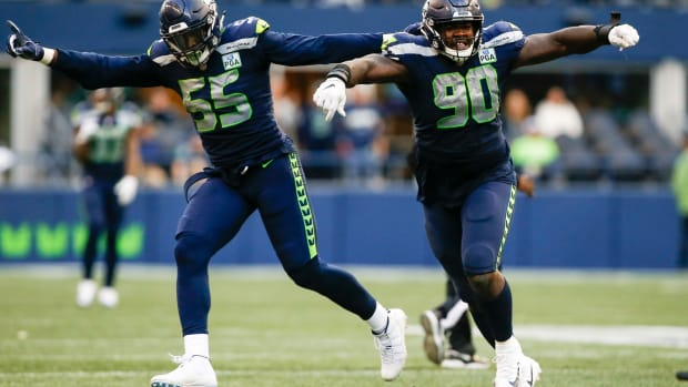 Nov 4, 2018; Seattle, WA, USA; Seattle Seahawks defensive tackle Jarran Reed (90) celebrates with defensive end Frank Clark (55) following a sack against the Los Angeles Chargers during the fourth quarter at CenturyLink Field. Mandatory Credit: Joe Nicholson-USA TODAY Sports