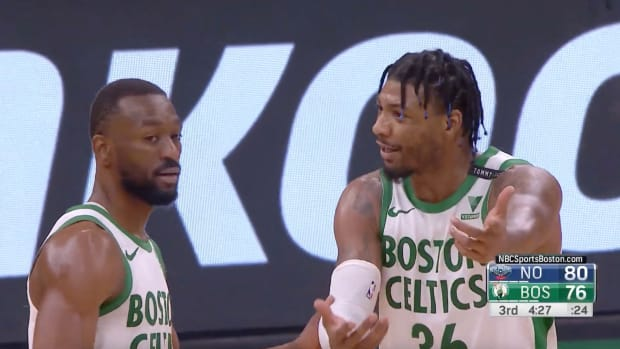 Marcus Smart and Kemba Walker react after Smart's turnover.
