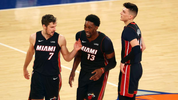 Dragić, Adebayo and Herro had reason to smile during Miami's 98–88 win over the Knicks.