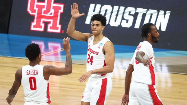 Houston's Quentin Grimes high fives Marcus Sasser