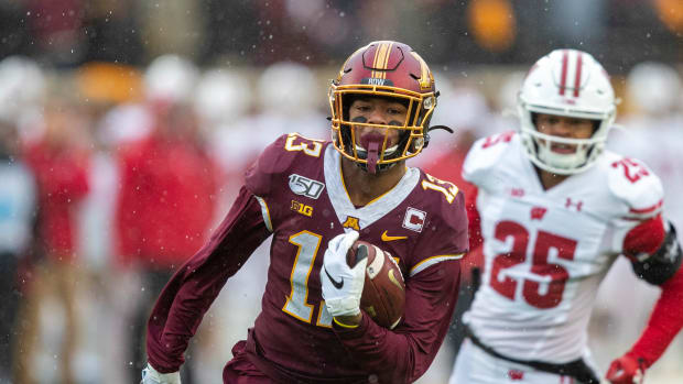 Caption: Nov 30, 2019; Minneapolis, MN, USA; Minnesota Golden Gophers wide receiver Rashod Bateman (13) catches a touchdown pass in the first quarter against the Wisconsin Badgers at TCF Bank Stadium. Mandatory Credit: Jesse Johnson-USA TODAY Sports