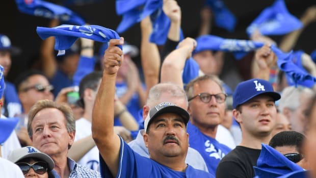 A Dodgers fan group is buying tickets in Anaheim to heckle the Astros.