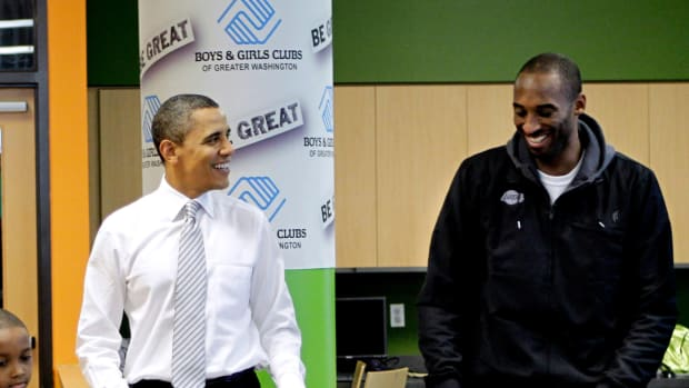 Barack Obama and Kobe Bryant on a visit to the Boys and Girls Club, in Washington, to prepare Christmas care packages